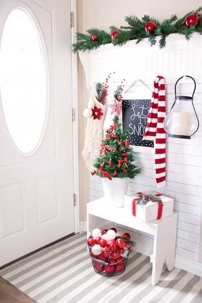 Looking for a fun, easy way to add some holiday life to your hallway built-in? Grab some red & white scarves and stockings and hang them on hooks. Colourful ornaments and presents can also add colour and holiday cheer to the space!