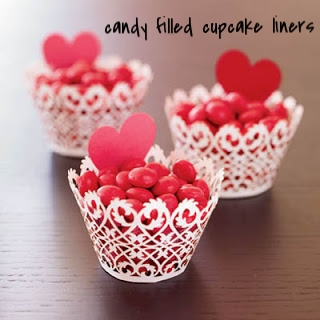 Have any fun cupcake liners hanging around your kitchen?? Fill them with Valentine candy and stick a heart on them! Place them around your house so everybody can have some Valentine's snacks!