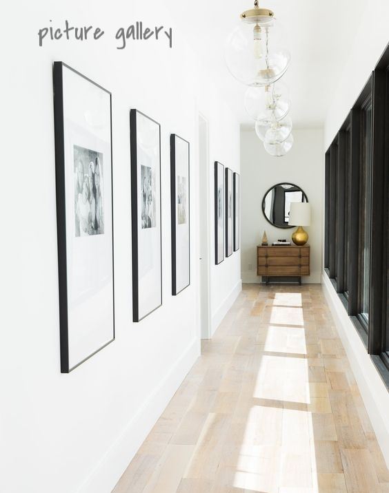 Making a picture gallery is probably the most popular option for hallway décor, but it can also be the most overwhelming. What pictures do you choose? How many do you need? Do you keep the picture frames all the same or change it up? How do you begin to hang them? Firstly, figure out what you want to showcase - artwork, family photos, etc. I personally love a wall of pictures frames that are all different - it adds tons of character to the space. With regards to where to start hanging, find the middle of the wall and just go for it. Hang the pictures straight, at random - it's completely up to you!