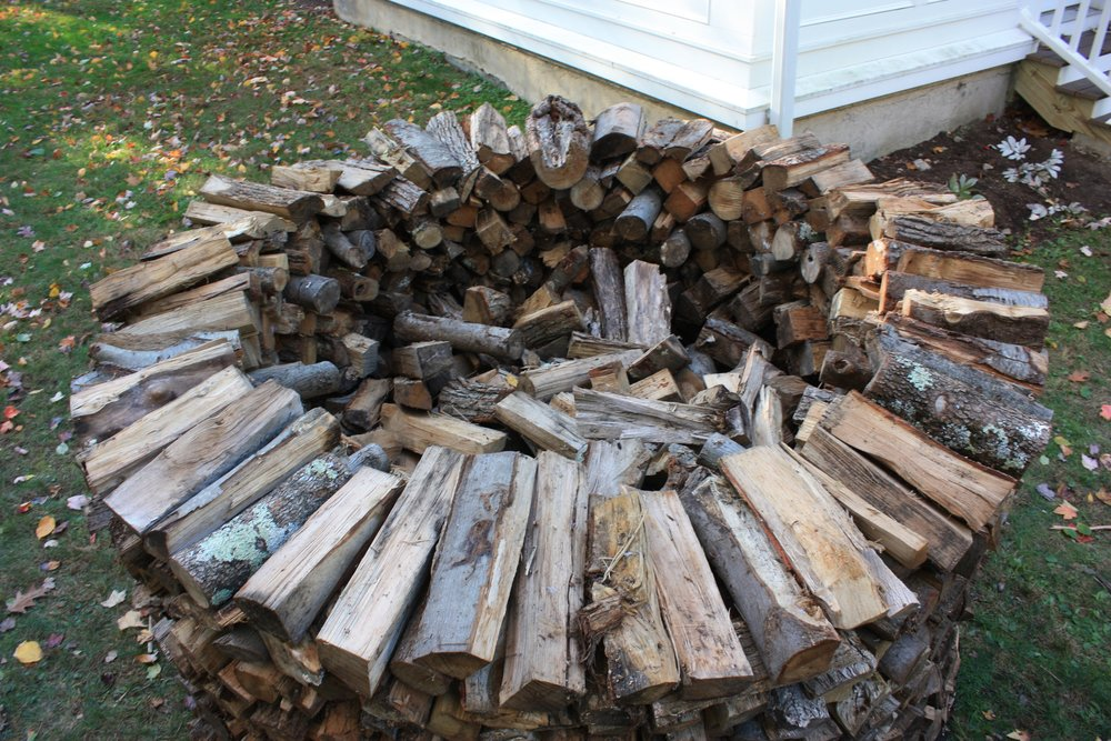 - Throw odd shaped logs, short logs and kindling scraps inside