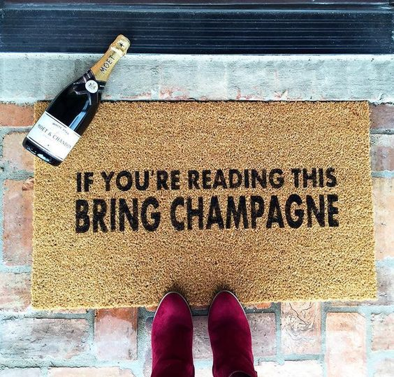 Bring Champagne Welcome Mat, $68.50 @ Moe Champs
