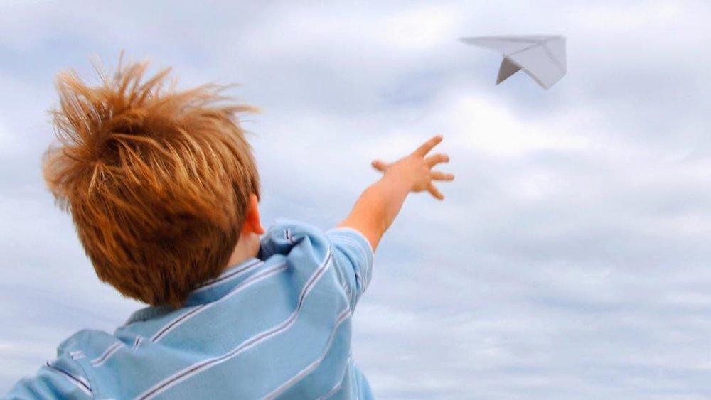 boy paper airplane.jpg