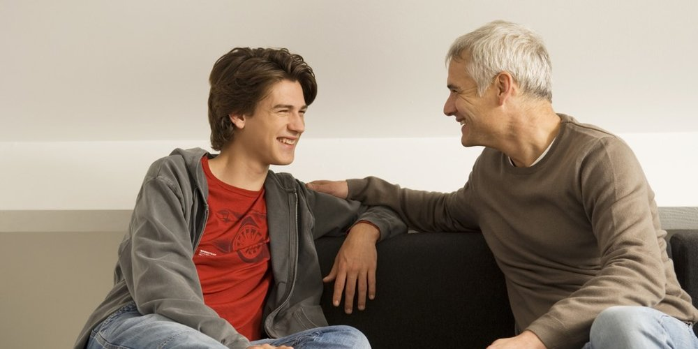 teen boy and dad on couch 1120.jpg