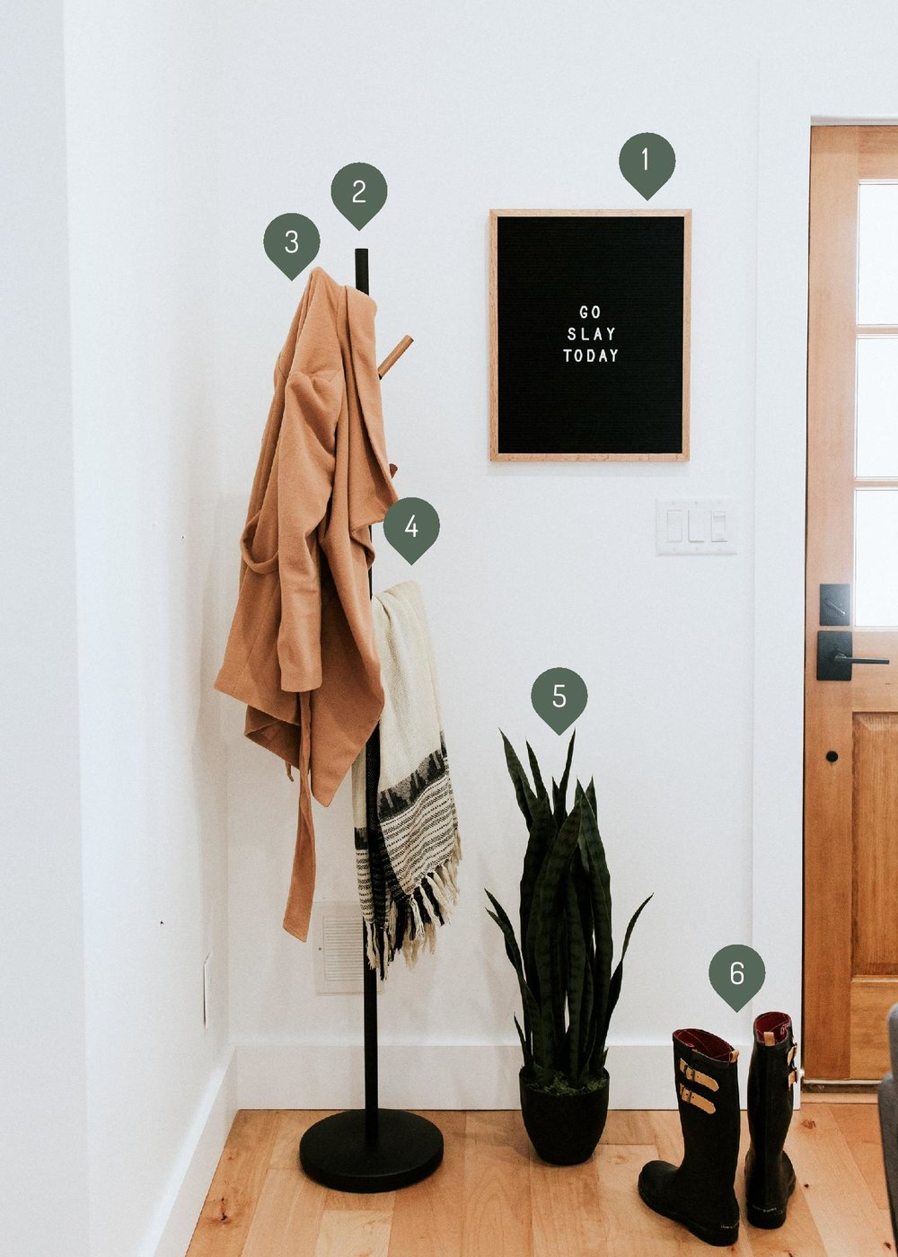 how we styled our entryway - modern minimal style inspiration featuring industrial coat rack, letterboard, rain boots, and snake plant sources