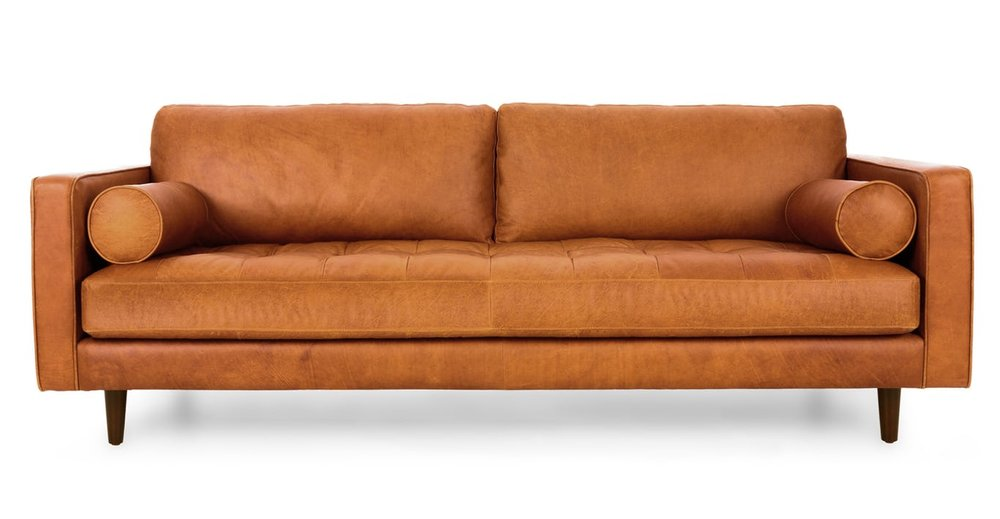 Leather couch from Article - A how to guide for artwork placement - how high to hang art and how far apart. Interior Design art hanging rules.