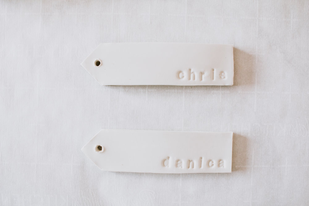 Creative gift wrapping with clay name tags. DIY personalized clay gift tags by Refined Design - clay name tags you can make from home! Perfect craft project and gift idea for weddings, Christmas, holidays, and birthdays. Custom clay Christmas ornament with names