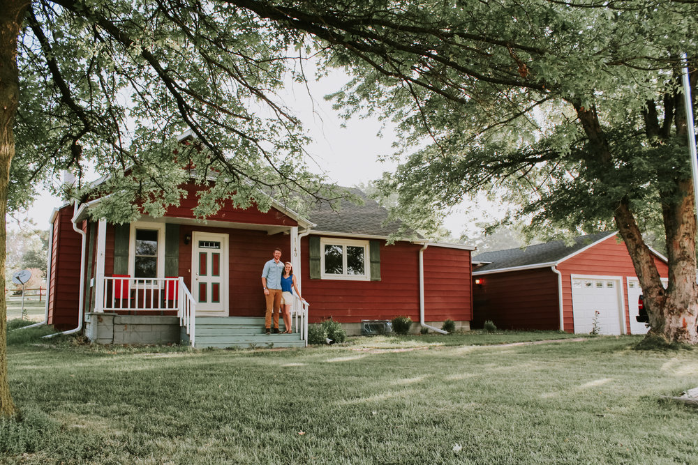 Snapped this photo right after we bought this home - our first and current fixer upper! Don't you just love the Christmas colors?? So looking forward to to day that we actually update the exterior!