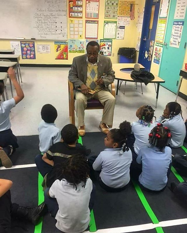 Detroit/Downriver APRI Chapter Youth Committee Chairperson Carl W. Baxter reading  to 1st graders at George Washington Elementary. Reach one, teach one! #4evercommunity4everapri