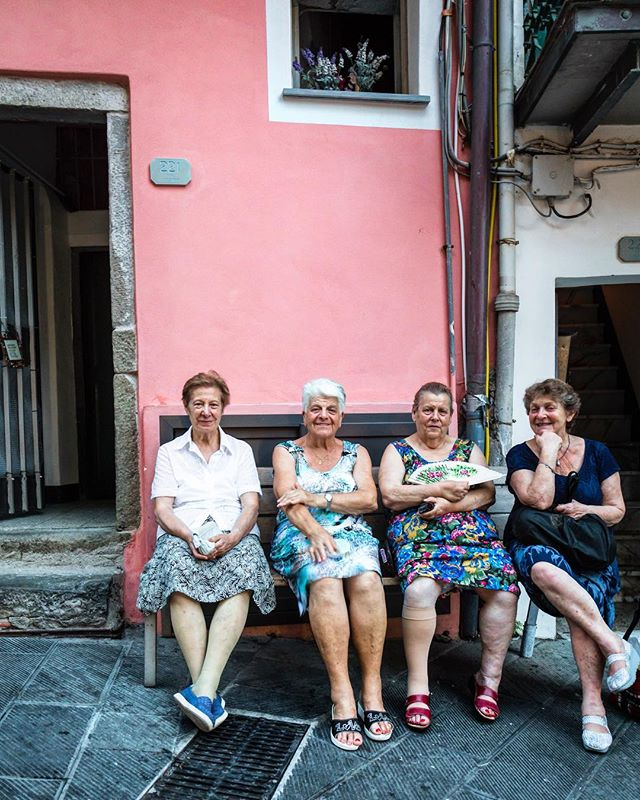 "I saw these four ladies in Riomaggiore, watching the tourists and passionately discussing... something. I had to ask for a photo, it was too 'quintessentially italian' to pass up. They asked (in Italian) if I was travelling by myself, ""solo?!"" (a question I got a lot), ""si! Perche no!"" ('why not!', my common reply). After one of them said she had an old rich son for me, I laughed through an ""arrivederci"". I saw them in the same place the next day, and the day after that passionately discussing... something. — I'm flying back to Melbourne today, and I'm feeling very sentimental. You're bound to hear a lot more from me on my thoughts on Italy in the coming weeks). Arrivederci bella Italia, tornerò!"