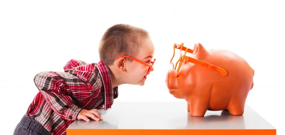 Kid and piggy bank.jpeg