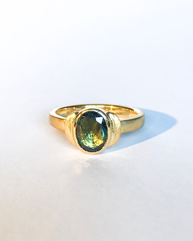 A gorgeously, simple and elegant engagement ring.  Australian parti sapphire set in 18ct yellow gold, with a rough finish.  Such a fun ring to make and such lovely humans to make for!