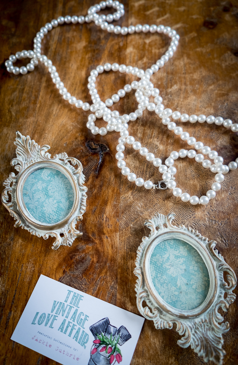 Picture frames from  The Vintage Love Affair.  Pearls from Sweet Pepper Vintage.