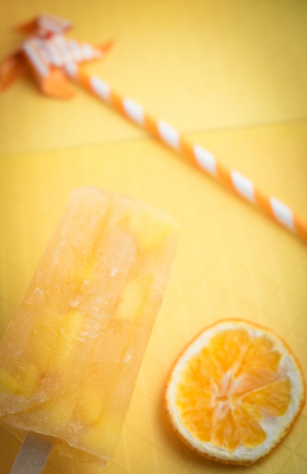 Peachy Orange Sangria Pops Hand.jpg