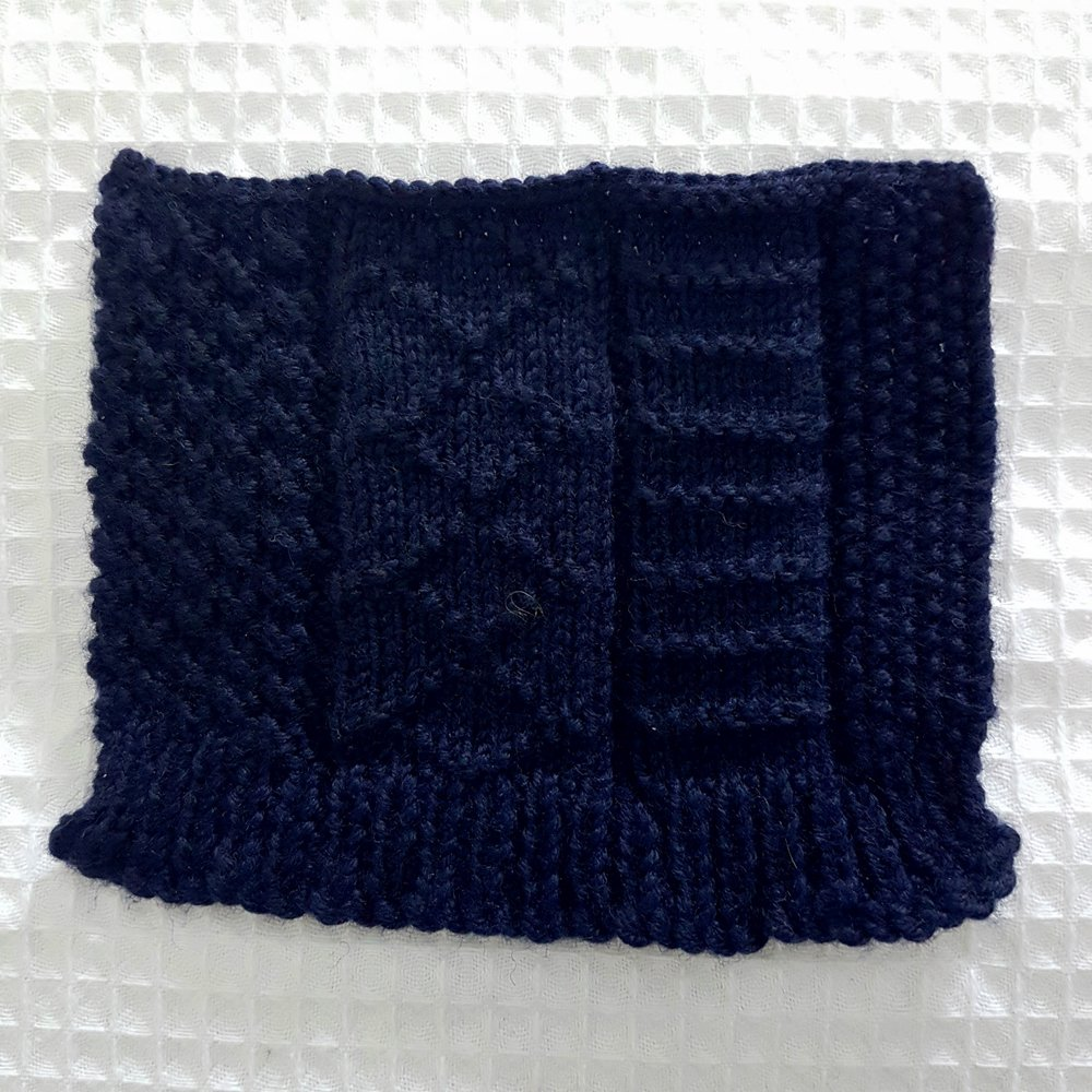 "My first attempt at a traditional Gansey stitch layout. I tried the ""double wool"" cast on, but find the way that it spreads unsightly. I think I need a bit of practice to get the balance right on the panelling too! Here, I used: double moss stitch, diamonds, ladder stitch and moss stitch."