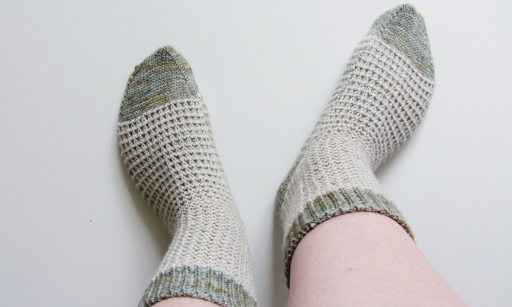 The sock has contrasting toes, heels and cuffs.