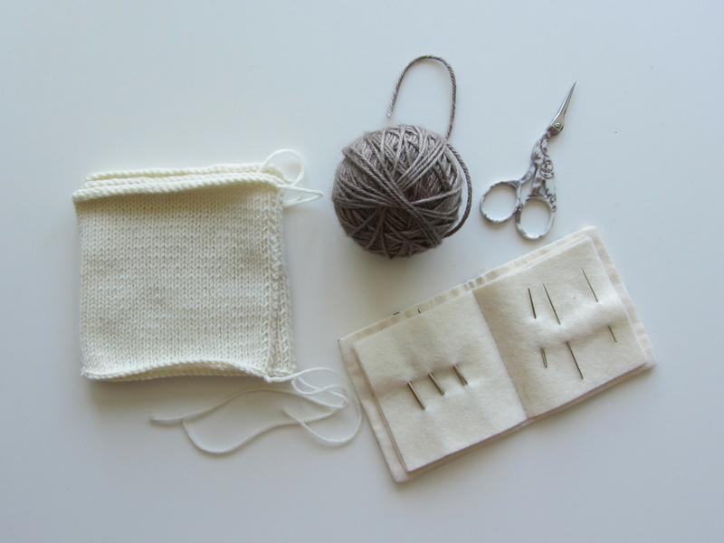 All you need to join your knitted pieces together using mattress stitch: yarn, a tapestry needle and a pair of scissors.