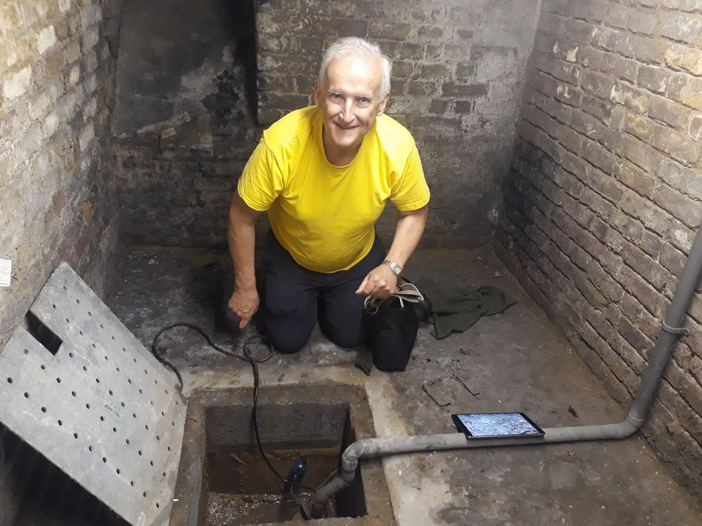 Fr James at the spring in the cellar