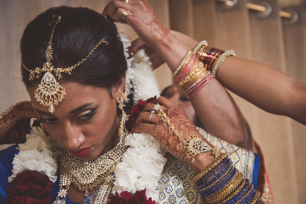 Hindu bride puts on garland for traditional Hindu wedding ceremony