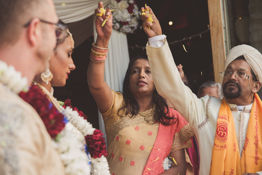 Throwing flower petals at Traditional Hindu wedding ceremony