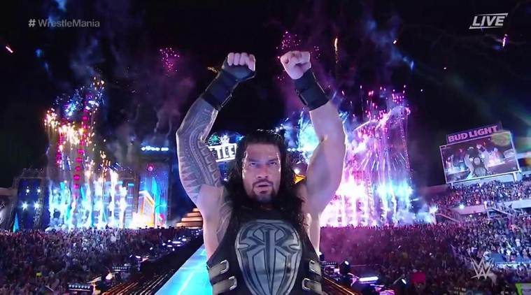 WWE/ CagesideSeats.com - Roman Reigns stands victorious at Wrestlemania 33