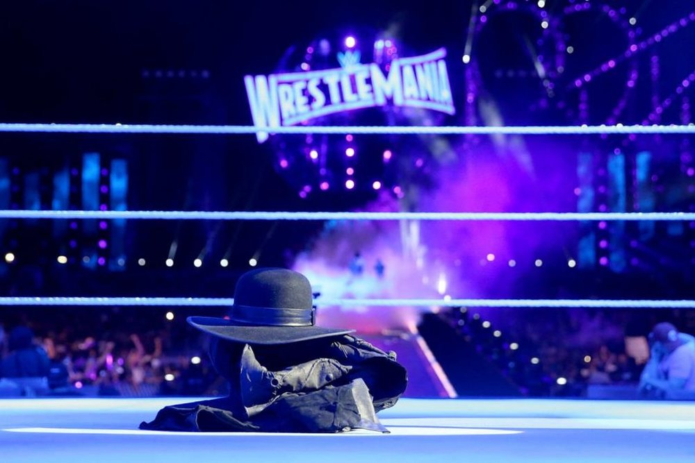 WWE/CagesideSeats.com - Undertaker leaves his gloves, coat and hat at Wrestlemania 33