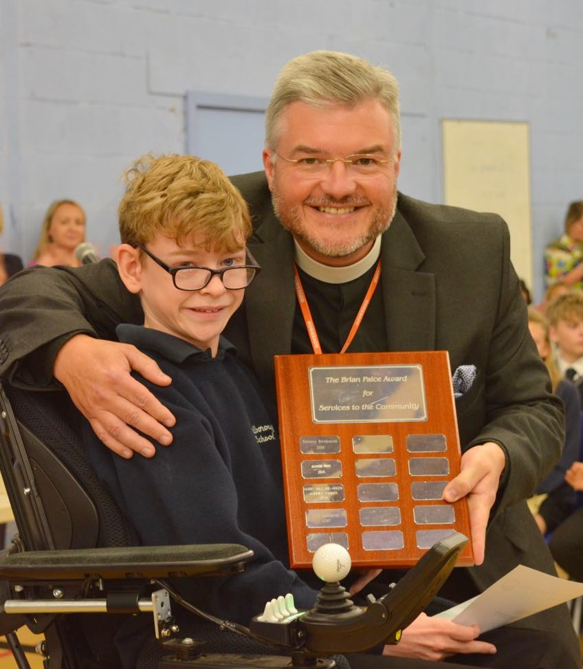Leo receives the Brian Paice Community Award from Adrian