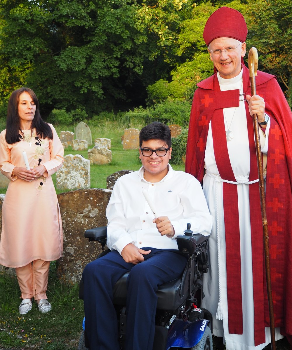 Gabriel at his confirmation with Bishop Colin last July, before the operation.