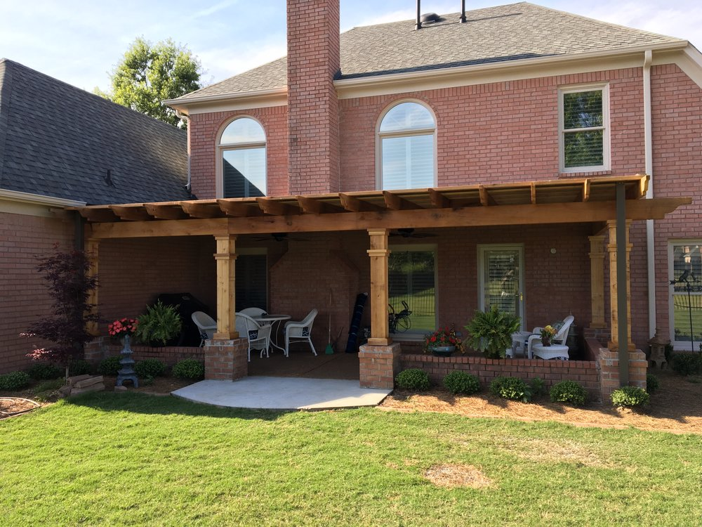 Solid Top Cedar Pergola This pergola was built with a self-contained gutter system to give our customer a great area to host guests.