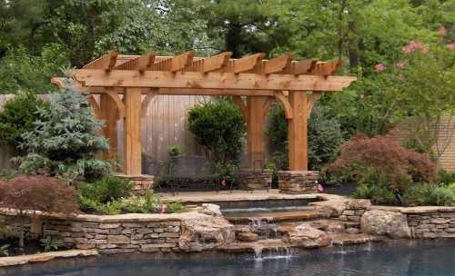 Waterfall-adjacent Pergola This pergola gave visitors a place to enjoy the beautiful gardens, stonework, and water with this open top design.