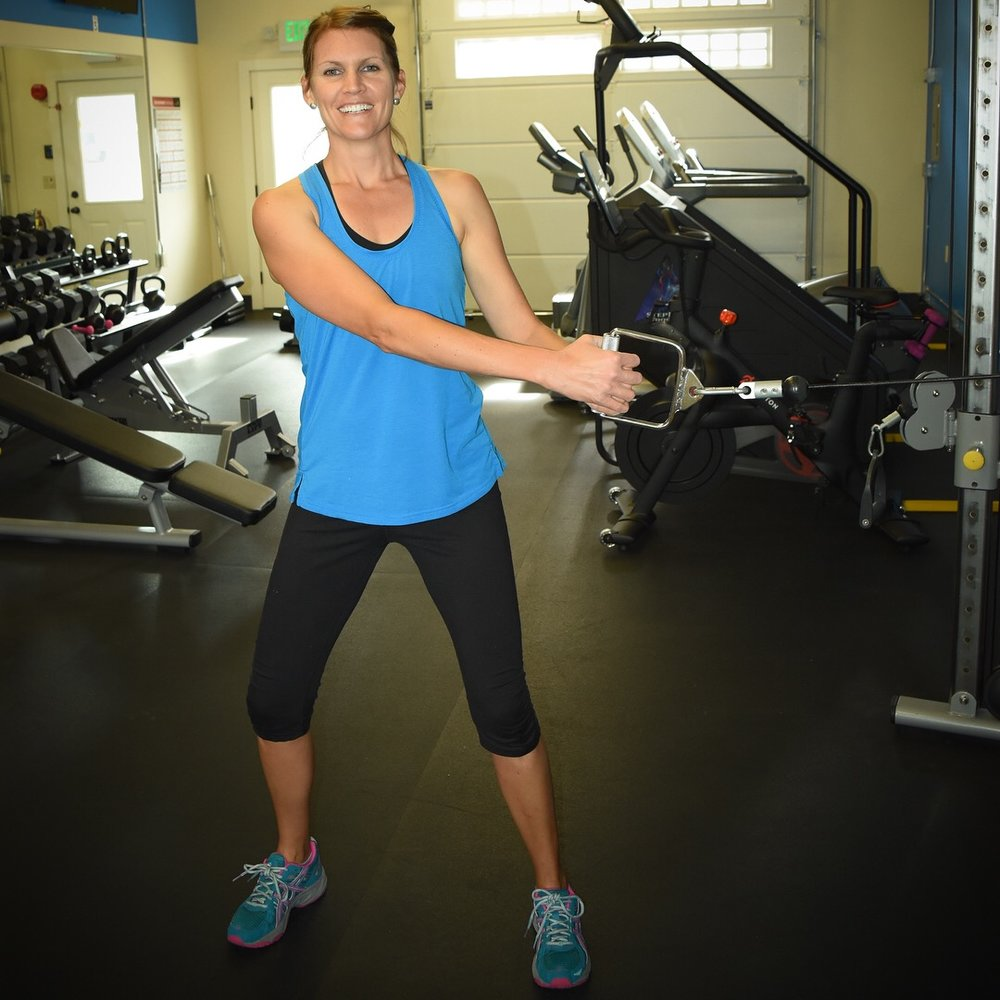 Kristin doing lateral wood chops using the dual functional trainer.