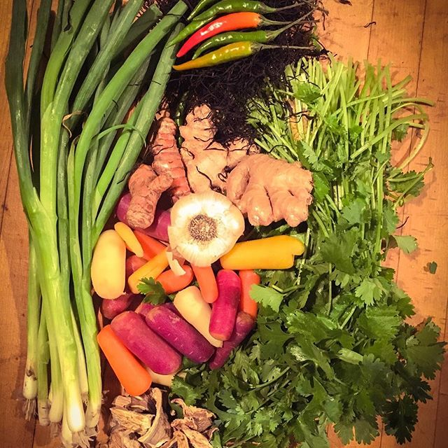 """Here's a super-quick healing and nourishing soup to make when the flu comes calling.  So as far as a recipe goes, I rarely measure in these cases...I pretty much go by taste and sight. Use as much water for the amount of soup you want to make, then chop and add: carrots, green onions, garlic, mushrooms (I used dried Shitake, Oyster, and Porcini), dandelion, and Thai peppers (I used one in this whole pot - they're spicy!). I peel and grate lemongrass, turmeric, and ginger - approximately a couple 1-2"""" pieces. Then add one or two handfuls of dried seaweed - I had Arame on hand, but you can use any kind or a blend. Once everything has cooked for about 15-20 minutes, I turn down the heat and start adding in the miso spoonful by spoonful, tasting as I go along to make sure it's flavored as I want. The miso should be salty enough that you don't need to add any salt. Depending on your tastes, you may want to add more ginger, lemongrass, or turmeric. I add cilantro to the bowl whenever serving, and sometimes I'll even squeeze some lemon in it as well. This soup has a lot of really powerful medicine in it and is really great during cold and flu season. Make up a big batch and then freeze it in smaller batches to have on hand whenever you need it. You can also strain out the solids and just drink the broth if you have an upset stomach. Good luck!"""