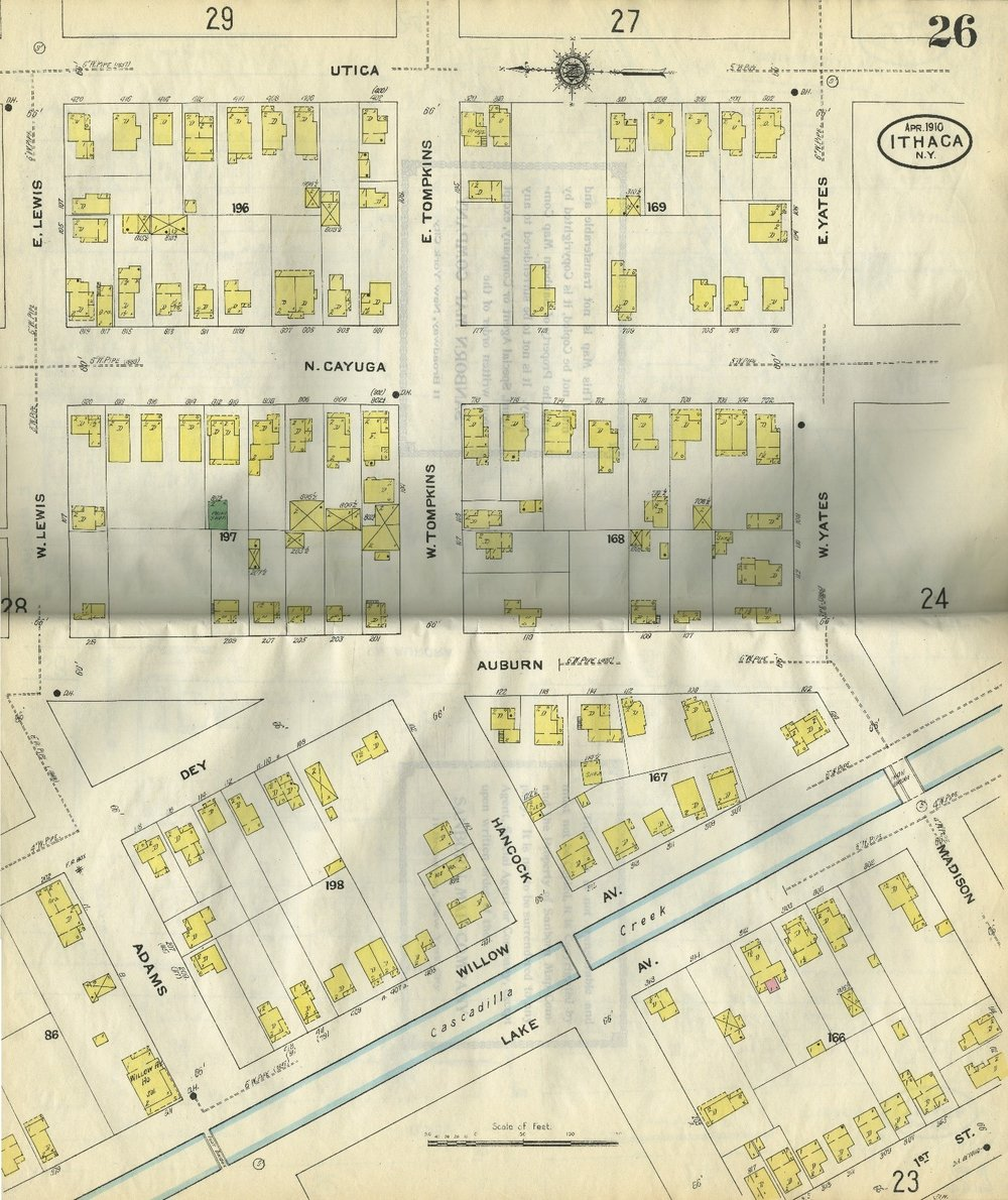 """Sanborn map of Ithaca from 1910. The yellow designates wood siding, and the letter D represents dwelling. The only building not colored yellow is labeled """"print shop."""" The color green designates a hazardous risk; in this case probably because of the inks used in the printing process."""
