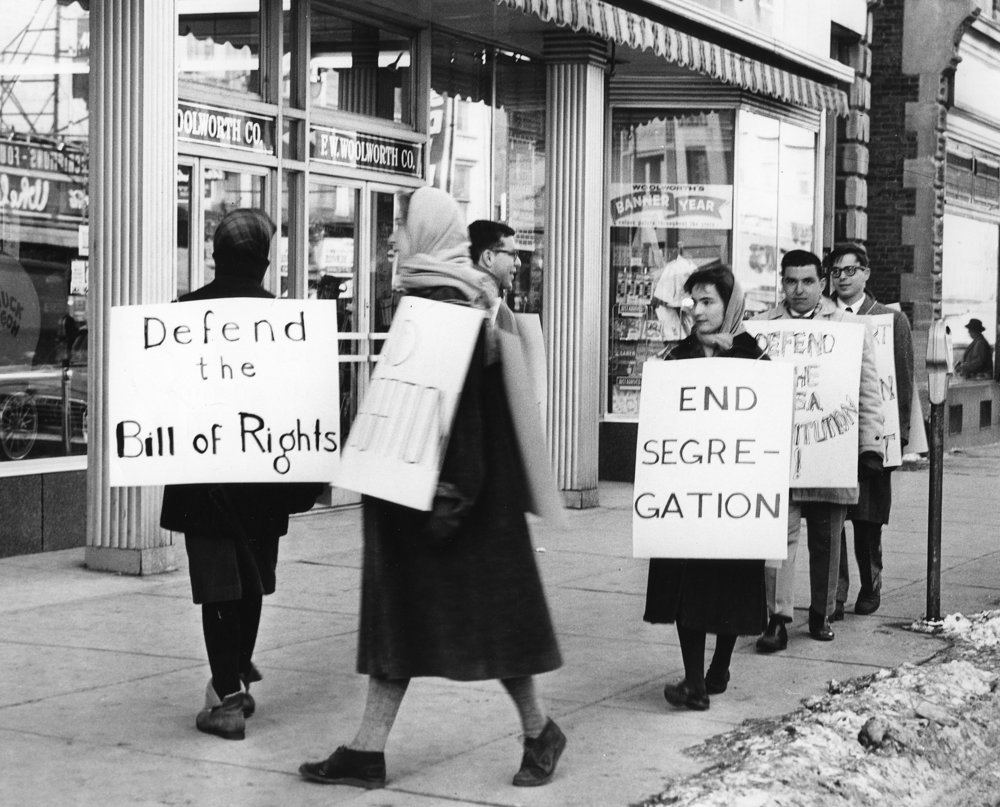 Protesters outside of Woolworths on the Commons. Image from the Photo Collection  at The History Center in Tompkins County.
