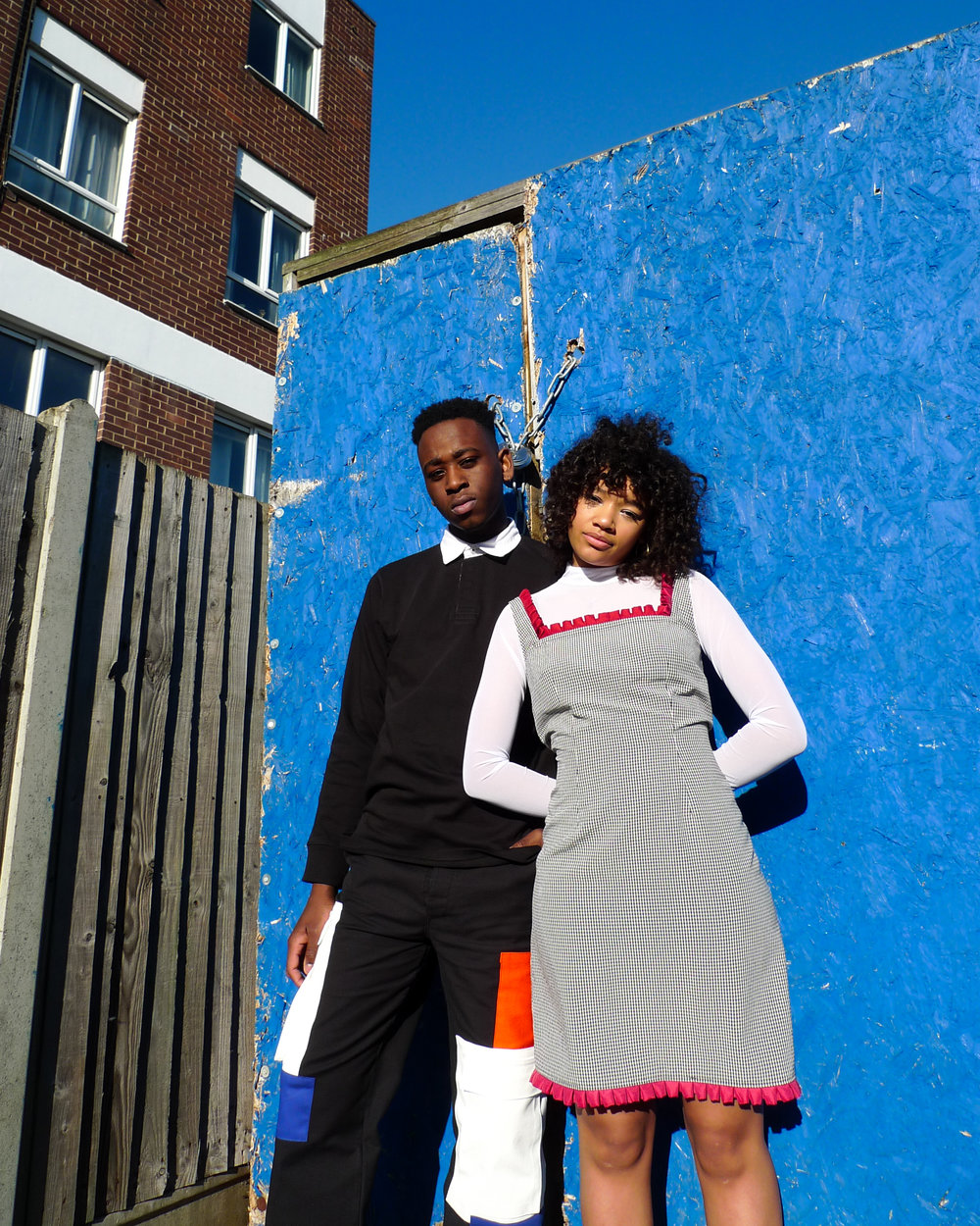 Salem wears ATIKA Studio Patch Pocket Trousers made from military surplus pieces and offcuts. Rosie wears Gingham Pleat Dress. Made from locally sourced fabric and silk shirt offcuts.