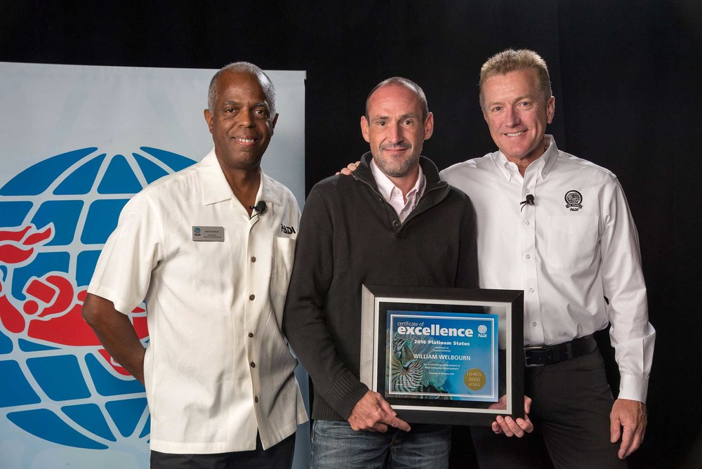 PADI Platinum Course Director William Welbourn receiving one of his platinum awards at DEMA in Las Vegas