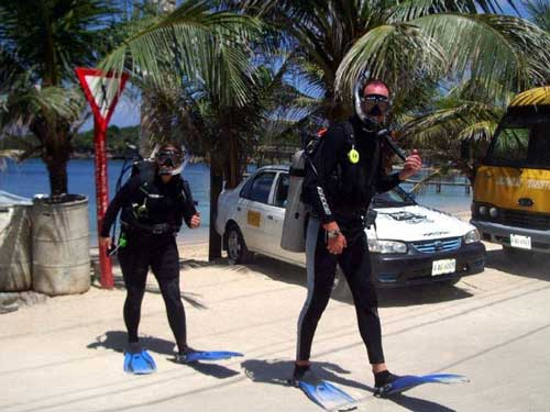 Divemaster Candidates crossing the road from the dive dock.