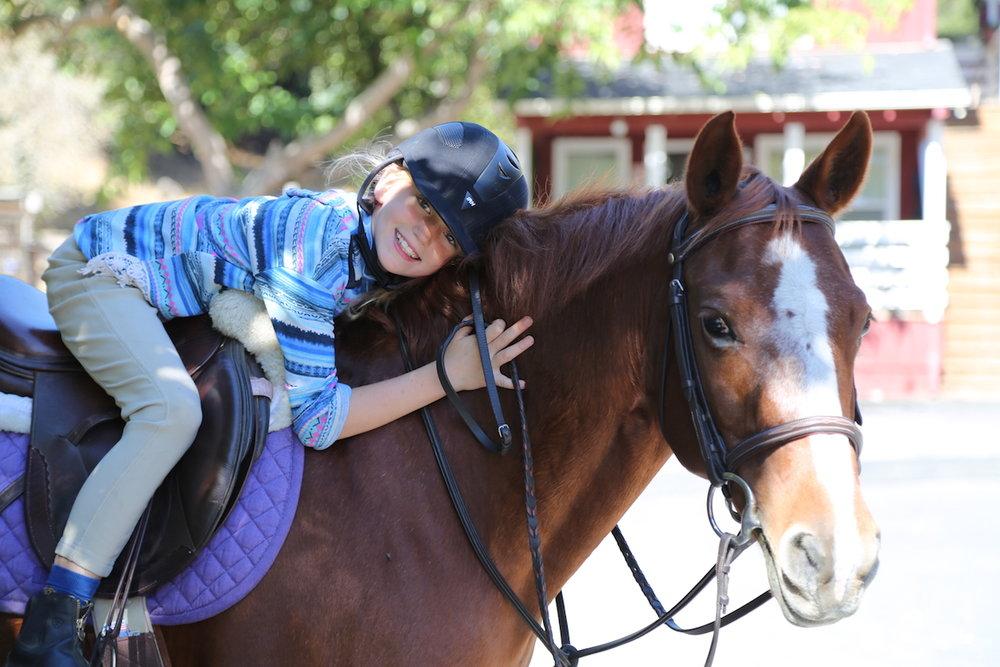 girl hugging horse.jpeg