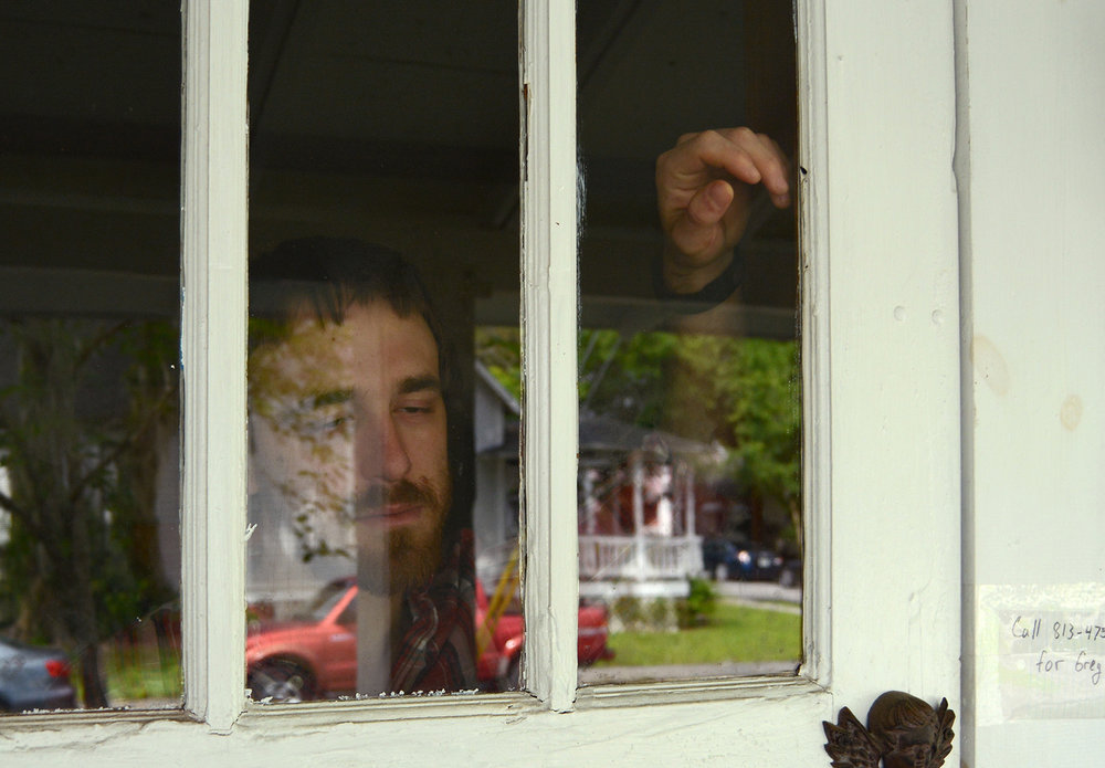 In this posed portrait, Greg watches the street from inside the confines of his home; in 2015 he pled guilty to conspiracy to deliver oxycodone and was sentenced to a yearlong house arrest and a four-year probationary period – if he fails, he could face up to 10 years in prison and $10,000 in fines.