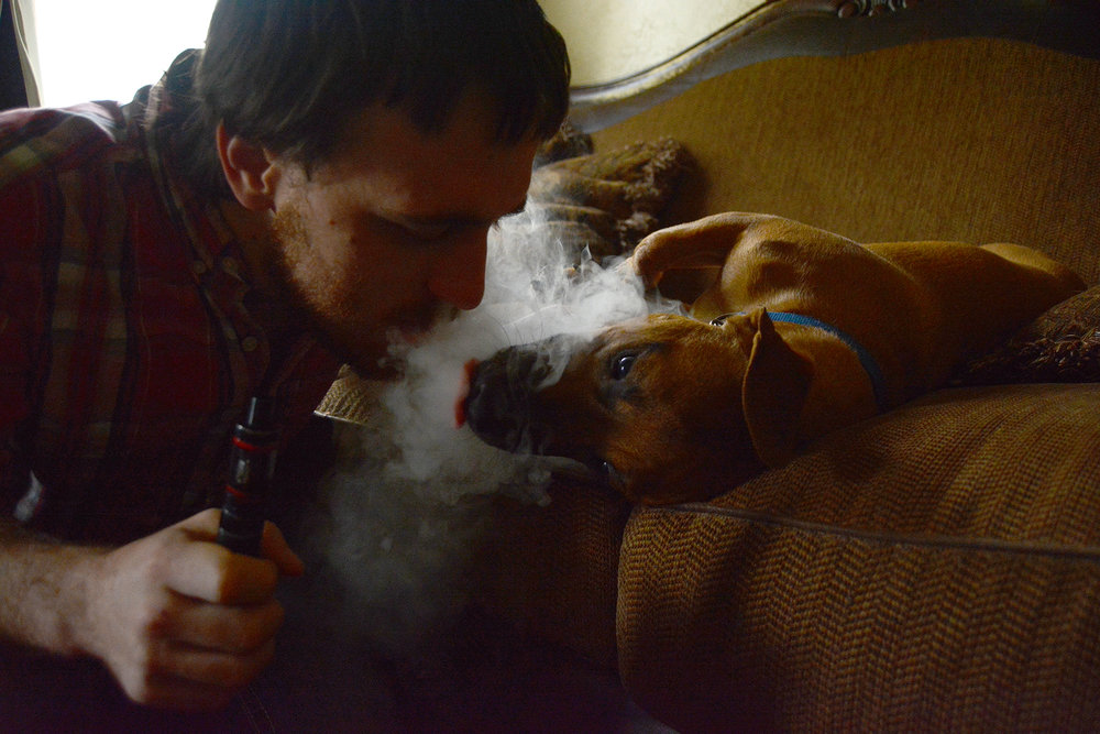 Greg occasionally switches from traditional cigarettes to an electronic cigarette, which he calls a safer alternative to smoking; Rusty seems to enjoy the citrusy odor of the e-cigarette and often follows his owner's vapor trails around the house.