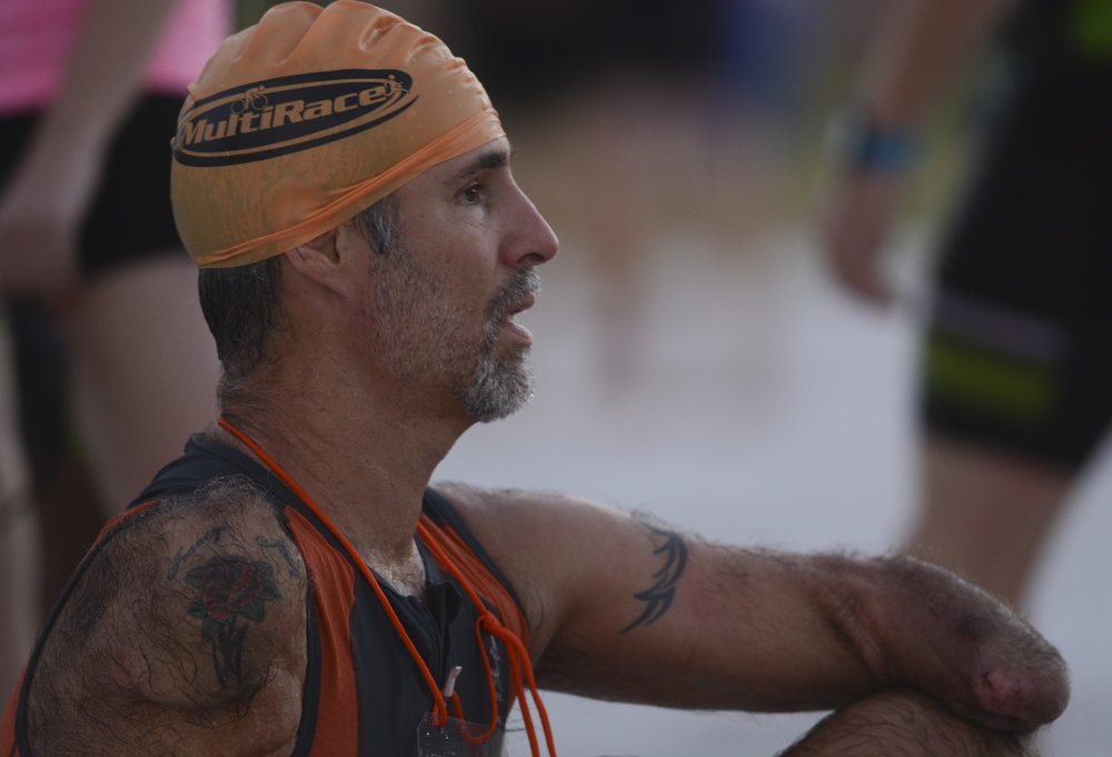 Picard sits after taking a moment to stretch before the swimming portion of the Tri Fort De Soto.
