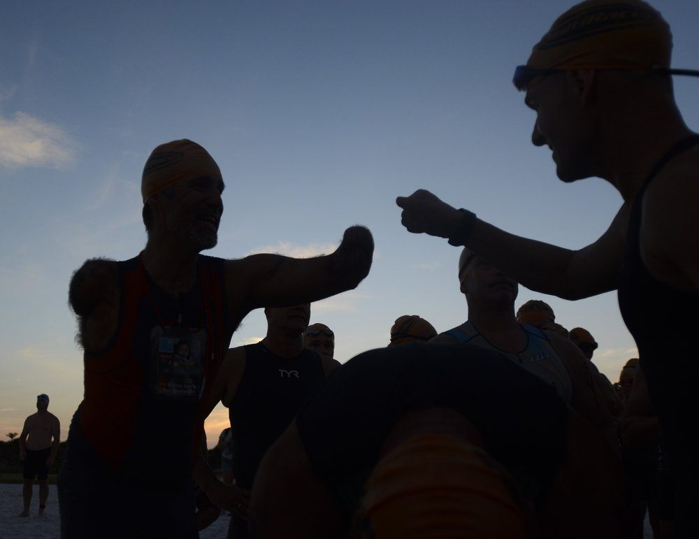 Moments before lining up at the starting line for the swimming portion of the triathlon, Picard greets a fellow competitor during the Tri Fort De Soto.