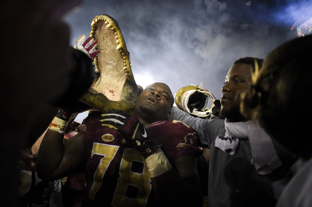 Florida State Seminoles offensive lineman Wilson Bell (78) carries a gator head after the game between the Florida State Seminoles and the Florida Gators at Doak Campbell Stadium in Tallahassee, Fla. on Saturday, Nov. 26, 2016. The Florida State Seminoles beat the Florida Gators 31-13.