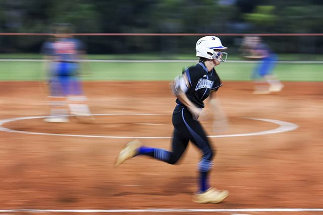 Been in a bit of a photo slump, but here's a frame I liked from softball tonight. Kid's got wheels.