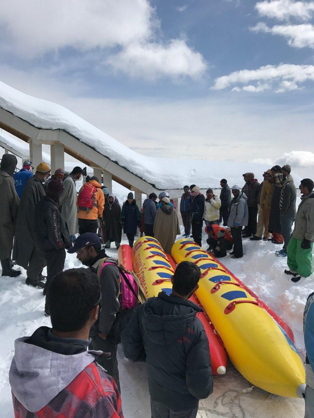 Banana Raft Rides Behind a Snowmobile
