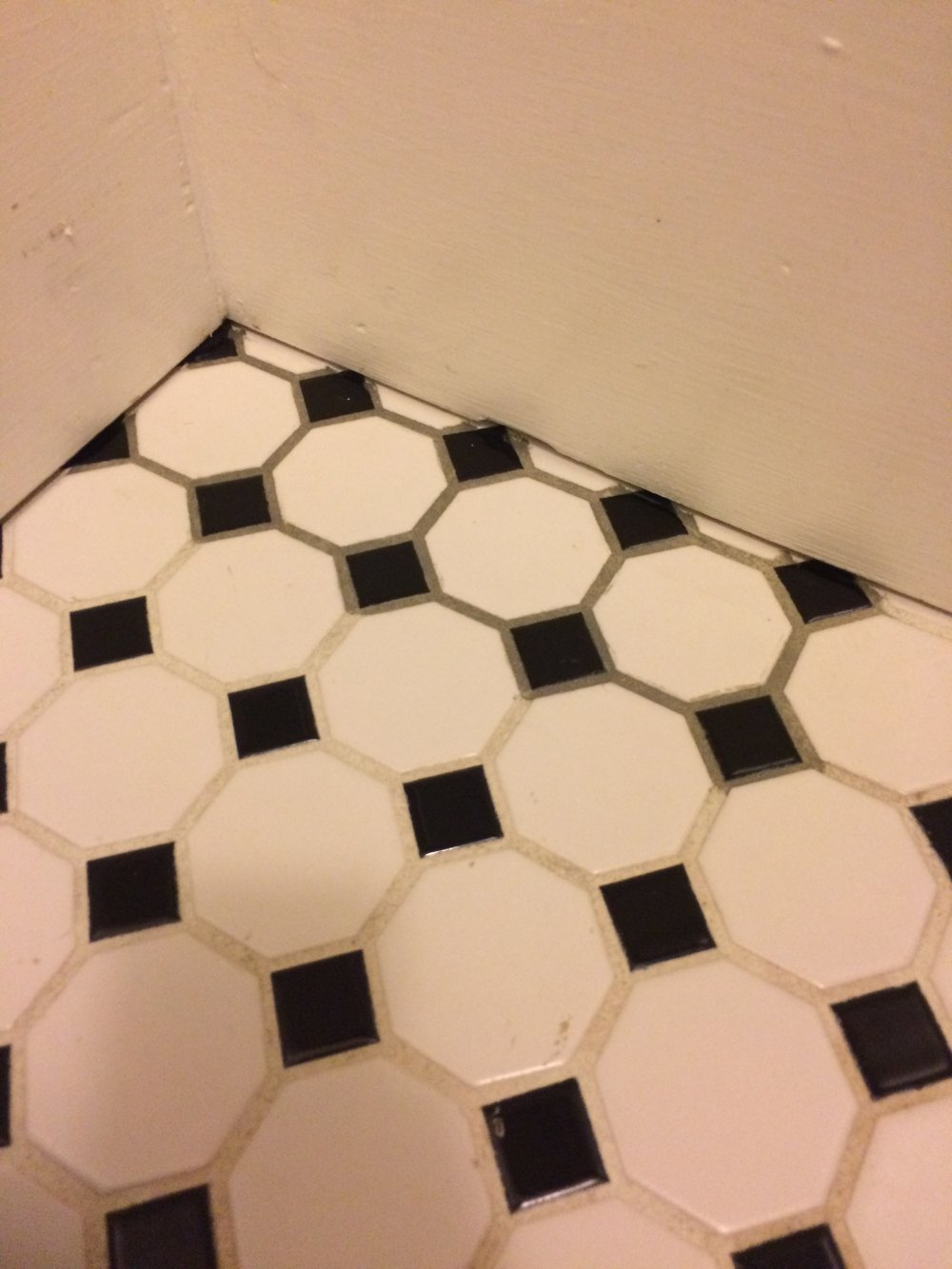 Here you can see the difference between the old white grout, and the grout that has been treated with PolyBlend Grout Renew.