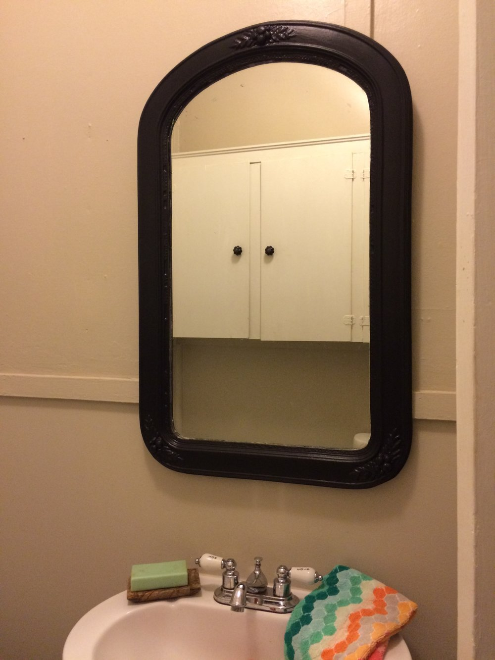 """The black changed the whole look of the mirror and really made the """"hot"""" and """"cold"""" stand out on our faucet!"""