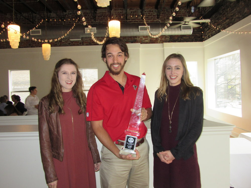 Featuring Magic City Match which received the Wayne W. Killion Sr. Innovation Award (left to right: Breanne DeBaets, Evan Piedrahita, and Caroline Irby).