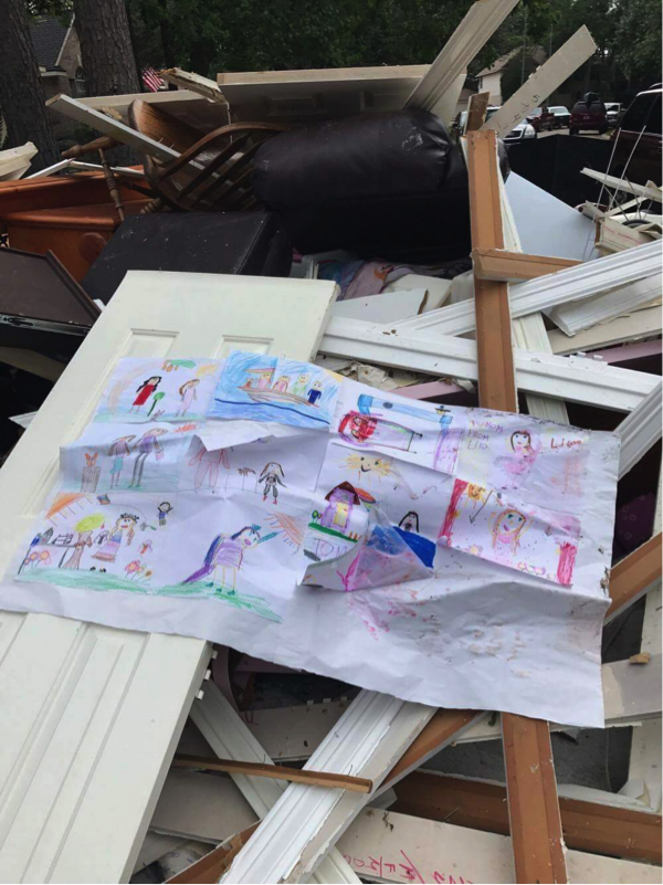 A child's drawing found in the rubble in Kingwood, TX.  Photos courtesy of Ashley Raggio, Chad Raggio, and Preston Miller.
