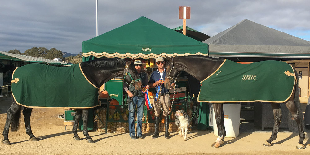 Good To Know and Julie Winkel, left, and Onyx with Andrew Jayne celebrate their championships.