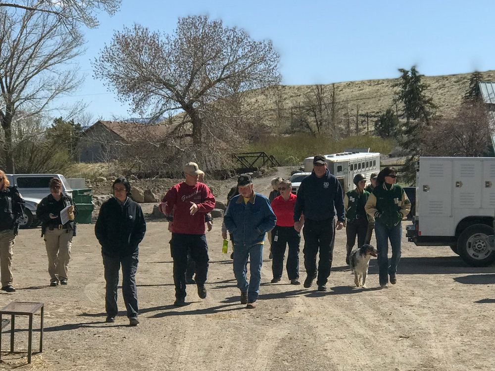 Julie Winkel, right, leads a group of First Responders to the pasture for training.